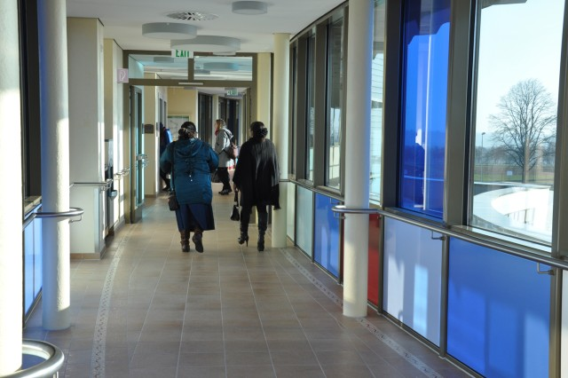 Guests stroll along one of the hallways in the new Wiesbaden Army Lodge.