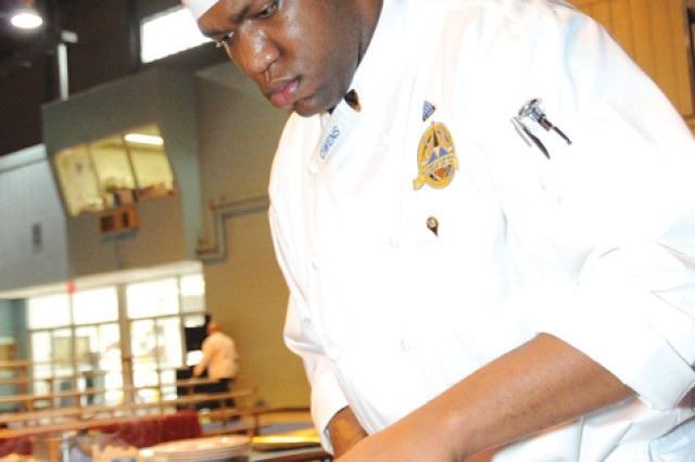 Spc. Keldrick Owens, Fort Hood Culinary Team, labors over a stove during the Practical and Contemporary Skills event Friday at the Post Field House.  ""