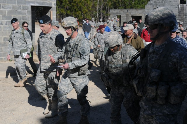 Gen. Peter W. Chiarelli (left), the Army vice chief of staff, Lt. Col. Curtis Buzzard (middle), commander of 1st Battalion, 505th Parachute Infantry Regiment, 3rd Brigade Combat Team, 82nd Airborne Division, and Col. Carl Alex (right), commander of 3rd Brigade Combat Team, discuss how Paratroopers would benefit from using the Joint Tactical Radio System (JTRS) Handheld, Manpack and Small Form Fit (HMS) during a training event at Fort Bragg, N.C., March 3.