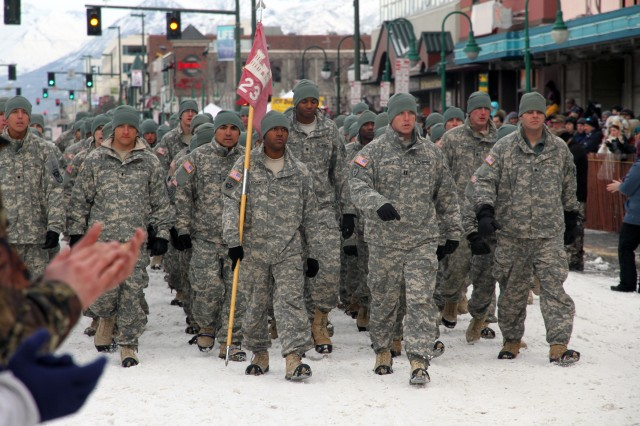 "ANCHORAGE -- The City of Anchorage welcomes home Soldiers of the 23rd Engineer Company (Sapper) from their yearlong deployment in Afghanistan. The Sappers marched through downtown before participating in the ""Running of the Reindeer"" March 5 during the city's Fur Rendezvous festival."