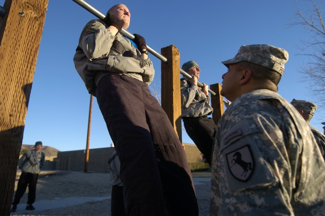 Soldiers from 11th Armored Cavalry Regiment perform chin-ups during the Pre-Ranger Assessment Course at Fort Irwin, Calif., Feb. 28. In order to pass the Ranger Physical Fitness Test, candidates must perform a minimum of 49 push-ups and 59 sit-ups, in two minutes each. The candidates must also finish a five-mile individual run in 40 minutes, and then perform six chin-ups.