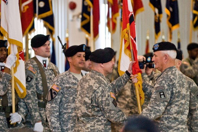 Maj. Gen. Kevin R. Wendel (second from right) takes the guidon of First Army Division East from Lt. Gen. Thomas G. Miller (right), current First Army Commander, as he assumes leadership of the multicomponent division in a change of command ceremony March 1 at McGill Training Center. Wendel assumed command from Maj. Gen. (P) J. Michael Bednarek, who served as First Army East's commanding general since June 2008.