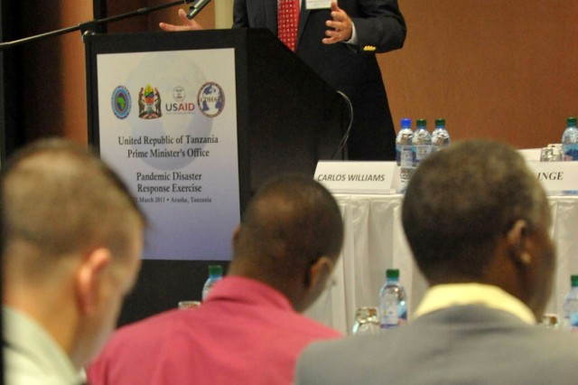 Joseph Inge, Center for Disaster and Humanitarian Assistance Medicine, discusses scenario guidelines with delegates to the Tanzania Pandemic Disaster Response Exercise March, 10 2011, in Arusha, Tanzania.