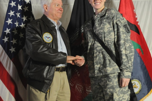 PARWAN PROVINCE, Afghanistan -- Secretary of Defense Robert Gates presents a coin to Pfc. Tiffany Jones, a human resources specialist with TF Falcon/10th Combat Aviation Brigade, March 7 at Bagram Airfield.