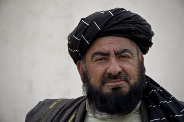 Panjwai district Governor Haji Faizluddin Agha, pictured here after a local shura Mar. 6, 2011, in Kandahar province's Panjwai district, emphasizes the importance of involving village leaders in helping secure the district for a better future.