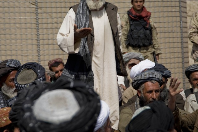 A village elder addresses Panjwai district Governor Haji Faizluddin Agha, at a local shura, Mar. 6, 2011, in a rural village in Panjwai district, Kandahar province, Afghanistan.