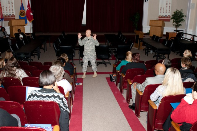 Maj. Gen. Nick Justice, APG senior commander, speaks March 9 at the Edgewood Conference Center during the 21st annual Federal Women's Program training conference.