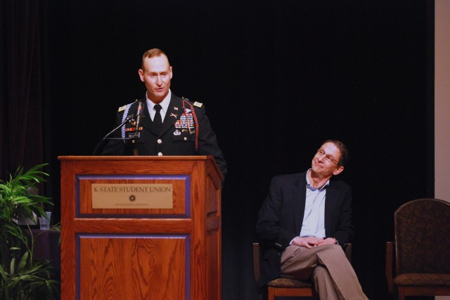 Col. Ralph Kauzlarich, Deputy Chief of Staff for Effects with the 1st Infantry Division, speaks during a lecture on 'The Good Soldiers' at Kansas State University March 10. The author of the book, David Finkel, is seated at the right.