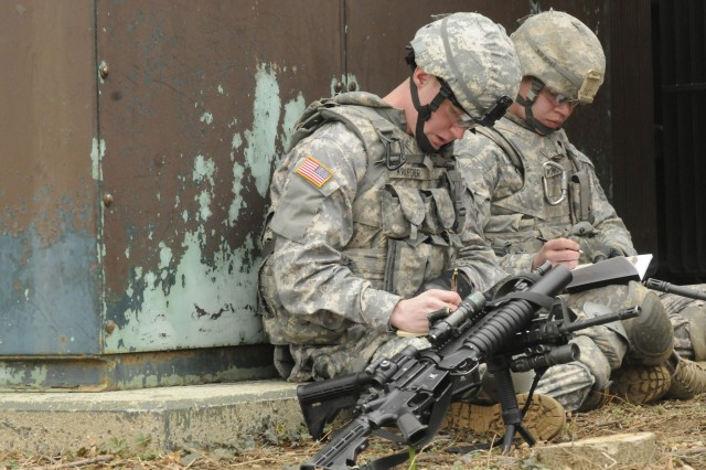 Charlie Company Soldiers, 3rd U.S. Infantry Regiment (The Old Guard), review Expert Infantryman Badge tasks during EIB training lanes at Joint Base Myer-Henderson Hall, Va., 9 March, 2011. EIB testing is slated to begin March 19, 2011, with an Army Physical Fitness Test and end March 23, 2001, with a 12-mile road march at Fort A.P. Hill, Va.