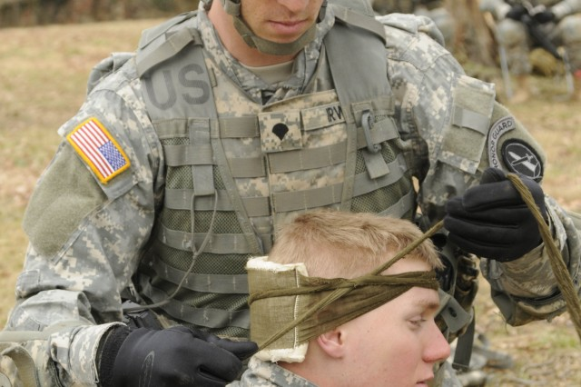 A Soldier with 4th Battalion, 3rd U.S. Infantry Regiment (The Old Guard), treats a simulated casualty at a first aid station during Expert Infantryman Badge training at Joint Base Myer-Henderson Hall, Va., March 9, 2011. The first aid training task is one of many that Soldiers must be proficient in to earn the Expert Infantryman Badge. EIB testing is scheduled to take place at Fort A.P. Hill, Va., 19-21 March, 2011.