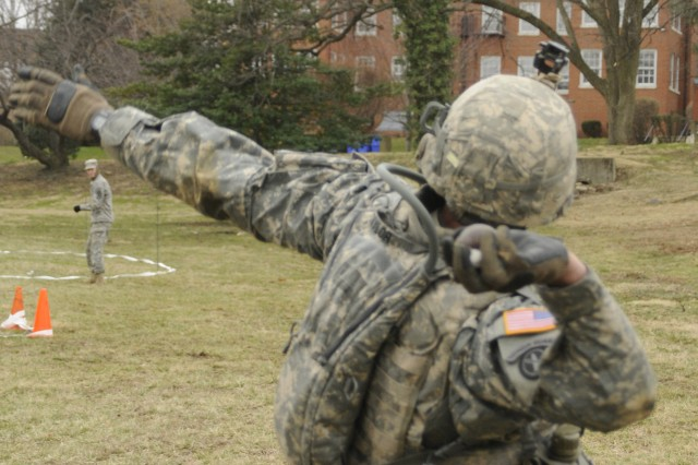 A Soldier with Charlie Company, 3rd U.S. Infantry Regiment (The Old Guard), employs a simulated hand grenade at an EIB training lane at Joint Base Myer-Henderson Hall, Va., 9 March, 2011. The training was conducted in preparation for upcoming EIB testing, scheduled 19-21 March, 2011, at Fort A.P. Hill, Va.