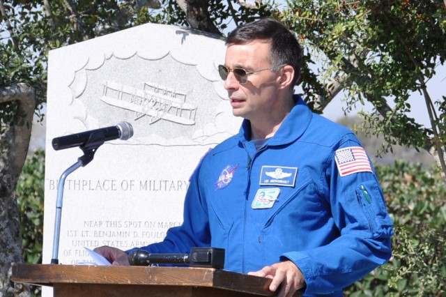 "Astronaut Air Force Col. Lee ""Bru"" Archambault describes what it feels like to fly on the space shuttle during the ceremony commemorating 101st anniversary of the first military flight March 2 at the Fort Sam Houston flagpole."