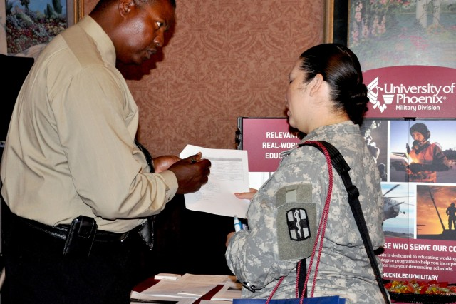 Larry Carlton, military education liaison, University of Phoenix, discusses educational opportunities available to servicemembers during the Hiring Heroes Career Fair March 8, at the Sam Houston Club.