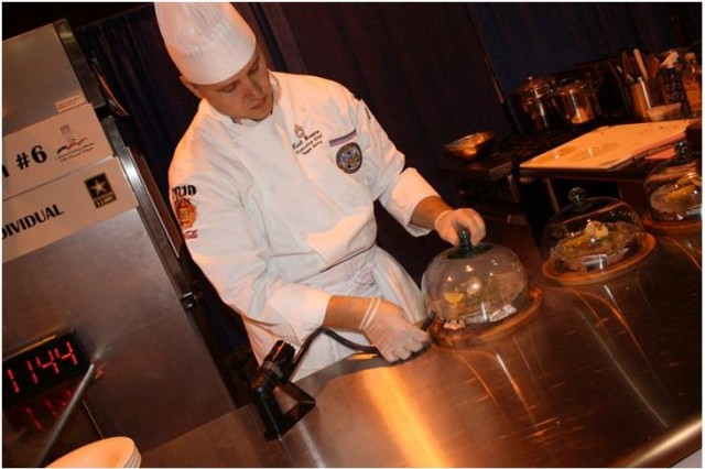 Sgt. 1st Class Steven Broome infuses his appetizer with smoke during the Enlisted Aide Competition at the 36th Culinary Arts Competition. Broom was named the Enlisted Aide of the Year during the culminating award ceremony on March 11, 2011.