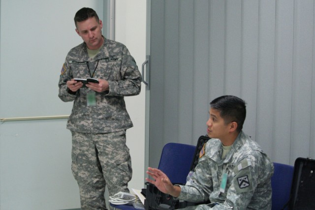 Battle Command Training Program Observer-Trainers discuss the conduct of an exercise while on temporary duty away from their Fort Leavenworth homestation. BCTP Soldiers routinely spend considerable time away from their post.