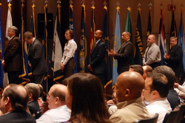 Team Redstone employees wait in line for recognition during the Deployed Workforce Recognition Ceremony on Thursday at Bob Jones Auditorium. It was the sixth such ceremony hosted by the commander of the Aviation and Missile Command.