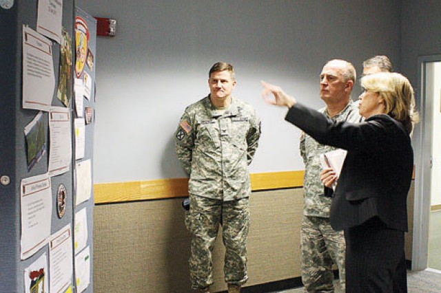 Nikki Crisman, assistant director for Family programs, CYSS, DFMWR, right, briefs IMCOM Commanding General Lt. Gen. Rick Lynch, center, on the Fort Riley Resiliency Campus during a March 3 visit to Fort Riley as Garrison Commander Col. Kevin Brown, left, looks on.