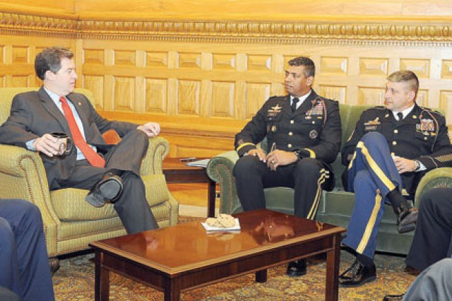 Kansas Gov. Sam Brownback, left, speaks with Maj. Gen. Vincent Brooks, 1st Inf. Div. and Fort Riley commanding general, center, and Command Sgt. Maj. Jim Champagne, 1st Inf. Div. command sergeant major, right, Feb. 24 at the capitol building in Topeka.