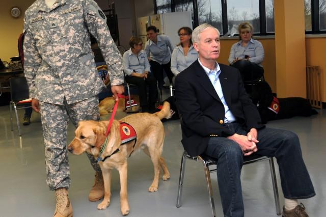 Sgt. Alvin Sanderson paces Edwin around retired Army Col. Gordon Sumner, secretary of Veterans Moving Forward's board of directors.