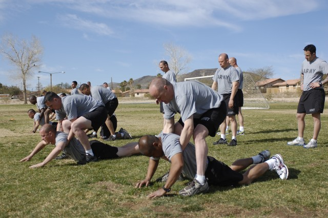 National Training Center Soldiers participate in a Soldier Carry exercise during a Physical Readiness Training familiarization course at Fort Irwin, Calif., March 10. The exercise is part of the Army's new PRT program, which is designed to improve trunk strength, stability and movement in the battlefield.