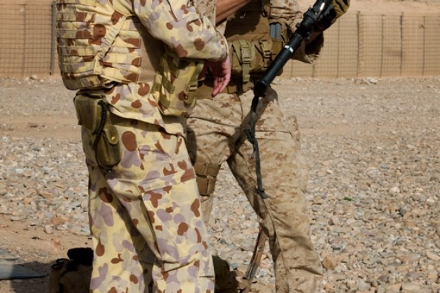 A U.S. Marine gives an overview of the M-4 rifle to an Australian soldier during a weapons familiarization range Mar. 11, at Multi-National Base Tarin Kot, Afghanistan. The purpose of the range was to give servicemembers from different countries a functional understanding of other nations' weapons.