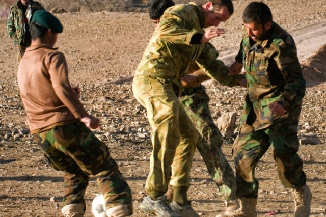 Australian Army Pvt. Christopher W. Cook, infantryman for Combat Team B, 5th Battalion, The Royal Australian Regiment, plays soccer Feb. 25 in Mirabad Valley, Afghanistan, with Afghan National Army soldiers. (U.S. Army photo by Spc. Edward A. Garibay, 16th Mobile Public Affairs Detachment)