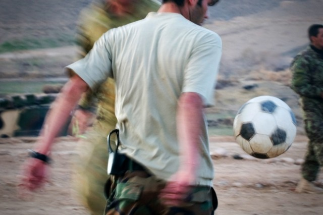 Afghan National Army 1st Lt. Mirwais Amiri, infantry platoon commander for 3rd Company, 3rd Kandak (Battalion), 4th Brigade, 205th  Corps Afghan National Army, lets a soccer ball fall to his side after stopping it with his chest Feb. 25 in Mirabad Valley, Afghanistan. Amiri used to play for the Afghanistan national soccer team. (U.S. Army photo by Spc. Edward A. Garibay, 16th Mobile Public Affairs Detachment)