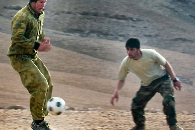 Australian Army Pvt. Christopher W. Cook, infantryman for Combat Team B, 5th Battalion, The Royal Australian Regiment, plays soccer Feb. 25 in Mirabad Valley, Afghanistan, with Afghan National Army 1st Lt. Mirwais Amiri, infantry platoon commander for 3rd Company, 3rd Kandak (Battalion), 4th Brigade, 205th Corps Afghan National Army. (U.S. Army photo by Spc. Edward A. Garibay, 16th Mobile Public Affairs Detachment)