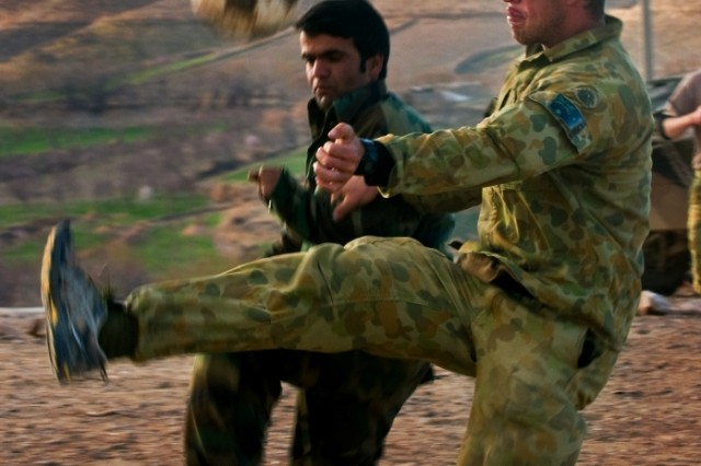 Australian Army Pvt. Christopher W. Cook, infantryman for Combat Team B, 5th Battalion, The Royal Australian Regiment, plays soccer Feb. 25 in Mirabad Valley, Afghanistan, with an Afghan National Army soldier. (U.S. Army photo by Spc. Edward A. Garibay, 16th Mobile Public Affairs Detachment)