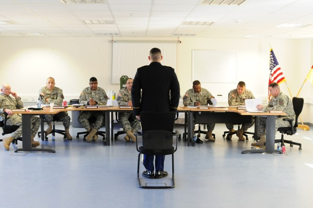Sgt. Bo Taylor, Headquarters and Headquarters Company, USAG Grafenwoehr, stands before the selection board during the final stage of the regional Soldier of the Year competition.