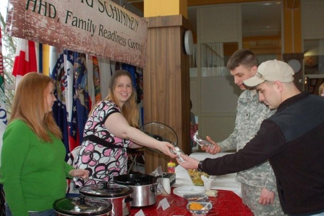 Elsa Cryderman (L) and Dennita Phillips (R) serve hungry customers at one of the monthly  Breakfast Burrito events hosted by USAG Schinnen's FRG.