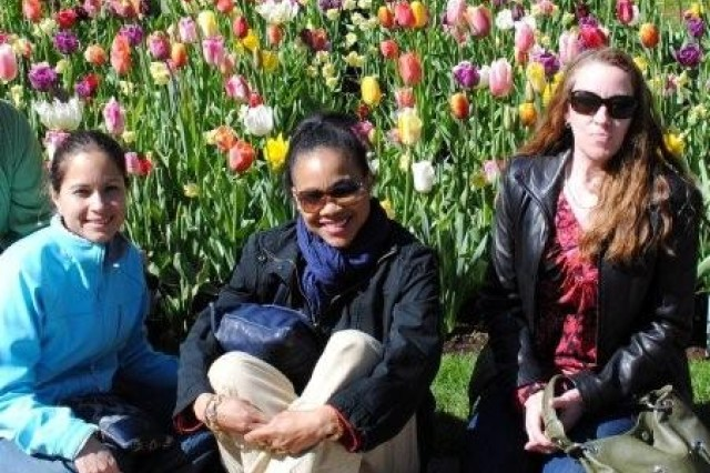 "Last year, the AFNORTH FRG took 30 single Soldier and married moms on a ""mothers only"" trip to Keukenhof Gardens. (L-R) Vivian Anaya, Lyra Kramer, and Joanne Cox enjoy the outing."