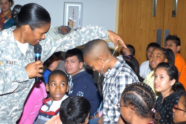 Col. Deborah Grays, U.S. Army Garrison commander, visits with students at Hapeville Elementary School as part of their Military Day event Feb. 17. Grays left the children with the message that they could be anything they want if they get a good education and make good choices.