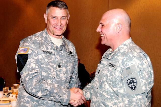 Sgt. Maj. of the Army Raymond F. Chandler III is welcomed to the AUSA Institute of Land Warfare breakfast by Maj. Gen. Genaro J. Dellarocco, commanding general of Army Test and Evaluation Command.