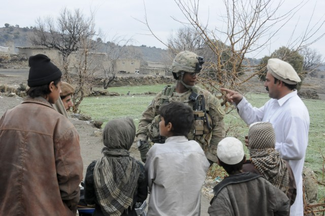 U.S. Army Sgt. Cecil L. Montgomery, an infantryman with 2nd Platoon, Co. D, 1st Battalion, 26th Infantry Regiment, 3rd Brigade Combat Team, 1st Infantry Division, Task Force Duke, and native of Many, La., listens to Afghan villagers during a patrol. The Fort Knox, Ky. - based TF Duke is currently serving a one-year deployment to eastern Afghanistan designed to assist the Government of the Islamic Republic of Afghanistan with transitioning to a more secure and stable government and lifestyle. (Photo by U.S. Army Staff Sgt. John Zumer, Task Force Duke Public Affairs Office)