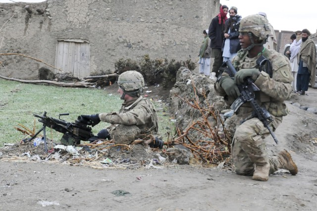 U.S. Army Sgt. Cecil L. Montgomery (right), an infantryman with 2nd Platoon, Company D, 1st Battalion, 26th Infantry Regiment, 3rd Brigade Combat Team, 1st Infantry Division, Task Force Duke, and native of Many, La., scans the security perimeter his platoon had just established in the village of Terkel, Khowst Province, Mar. 1. He stands next to U.S. Army Pfc. Alex Thomas, an infantryman from Chattanooga, Tenn. The two Soldiers were on a dismounted patrol with their platoon, meeting villagers and other key leaders in their area of operations. The 3/1, a Fort Knox, Ky. - based unit, is presently serving a one-year deployment to eastern Afghanistan designed to assist the Government of the Islamic Republic of Afghanistan with transitioning to a more secure and stable government and lifestyle. (Photo by U.S. Army Staff Sgt. John Zumer, Task Force Duke Public Affairs Office)