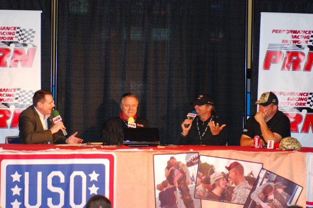 "NASCAR driver Ryan Newman (far right) and former racer Kyle Petty (2nd from right) talk with Doug Rice (2nd from left) of the Performance Racing Network and Scott Cooper(far left), vice president of communications for Charlotte Motor Speedway. The show was to promote the ""Let the troops race"" program at CMS for the upcoming Memorial Day weekend race. Petty and Newman answered questions from audience in attendance and also signed autographs and took pictures with the fans after the show. The show was held at Sports USA on Monday. (Photo by Staff Sgt. Shelman Spencer, 82nd Airborne Division Public Affairs)"