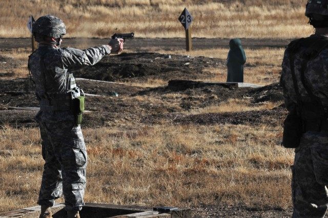 1st Lt. William Smith shoots his targets during the 100th Missile Defense Brigade (Ground-based Midcourse Defense) pistol qualification range at Fort Carson, March 10, 2011.