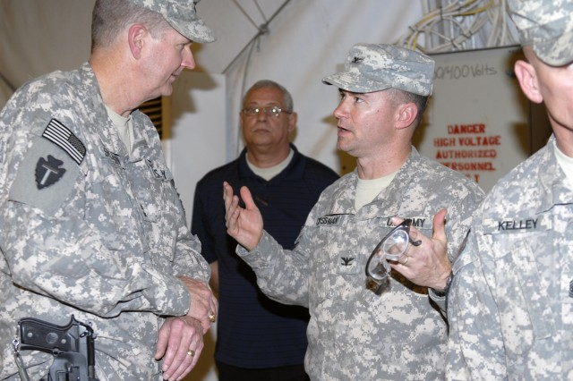 CONTINGENCY OPERATING BASE ADDER, Iraq - Col. Douglas Crissman, commander of 3rd Advise and Assist Brigade, 1st Cavalry Division chats with Maj. Gen. Eddy Spurgin, commander of 36th Infantry Division and United States Division - South. The Greywolf Brigade took over authority of the Muthanna, Dhi Qar, Mayson and Basrah Provinces of United States Division - South for the 3rd Advise and Assist Bde., 4th Inf. Div. of Fort Carson, Colo. March 12 at a transfer of authority ceremony.