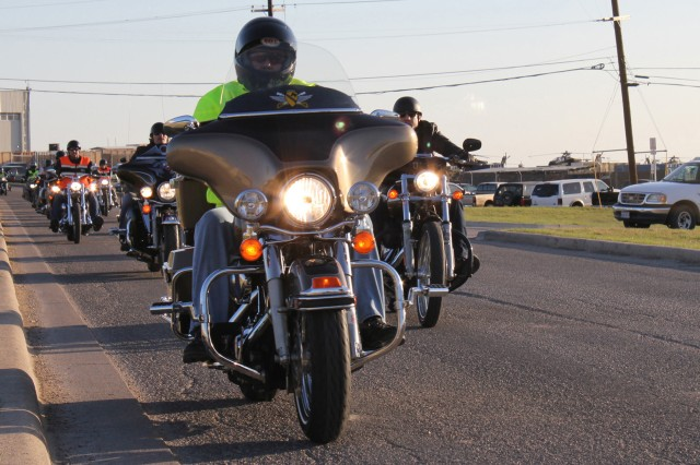 """FORT HOOD, Texas - Command Sgt. Maj. Glen Vela, of Fort Worth, Texas, 1st Air Cavalry Brigade, 1st Cavalry Division, leads Soldiers from his brigade on a motorcycle ride March 9. Participating in the ride included Theo Rossi and Kim Coates, stars of the show """"Sons of Anarchy."""" The ride began at Robert Gray Army Airfield."""