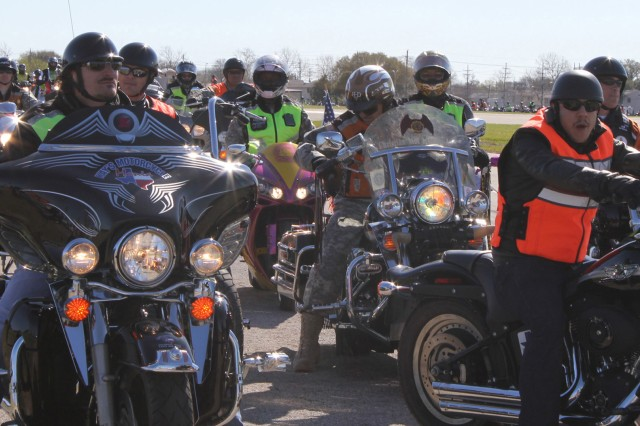 """FORT HOOD, Texas - Kim Coates (left), and Theo Rossi (right), stars of the show """"Sons of Anarchy"""", prepare to embark on a motorcycle mentorship ride along with Fort Hood Soldiers March 10. The purpose of the ride was to promote motorcycle safety which began and ended at III Corps Headquarters."""