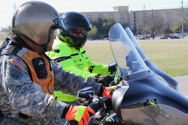FORT HOOD, Texas - Command Sgt. Maj. Arthur Coleman, III Corps, (left), and Command Sgt. Maj. Glen Vela, 1st Air Cavalry Brigade, serve as lead riders during a post-wide motorcycle mentorship ride, March 10. The ride took the Soldiers from III Corps Headquarters to the Belton Lake Outdoor Recreational Area and back.