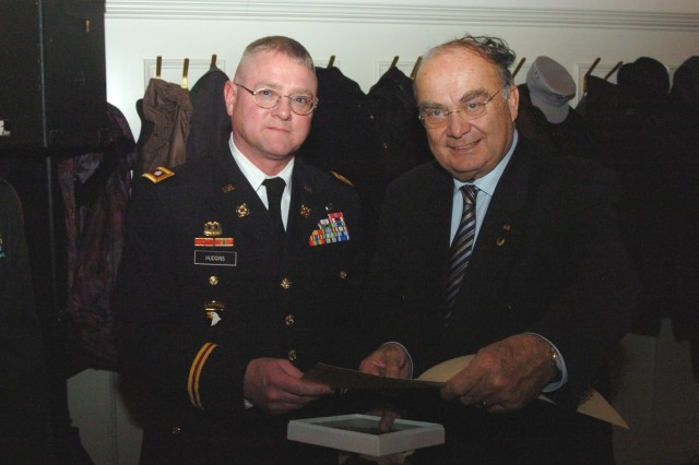 Lt. Col. Reed Hudgins, the 18th Combat Sustainment Support Battalion commander, accepts an award for the battalion Feb. 24 from an official for the German War Graves Caring Association for his unit's participation in the 2010 donation drive. The 18th CSSB donated 775 Euros in 2010.