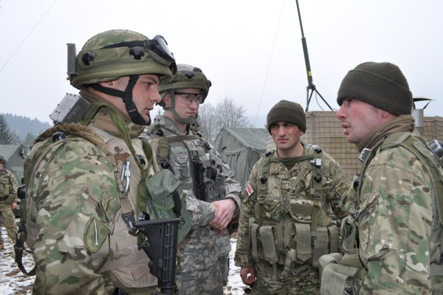 2nd Lt. Anthony Cichorz, platoon leader for 42nd Clearance Company, 54th Engineer Battalion, from Chesapeake, Va. speaks with Soldiers from the Georgian National Army 33rd Infantry Battalion during a training exercise in Hohenfels Feb. 27.
