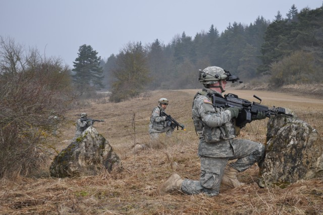 Pfc. Max B. Wolfer (right), from Vancouver, Wash., and Pvt. Eric A. Alcante, from Chicago, both combat engineers with 42nd Clearance Company conduct dismount operations during a route clearance mission in Hohenfels Feb. 27. The 42nd Clearance Co. conducted route clearance patrols Feb. 14 to March 2 in support of the 33rd Infantry Battalion to provide them freedom of mobility throughout their area of operations.