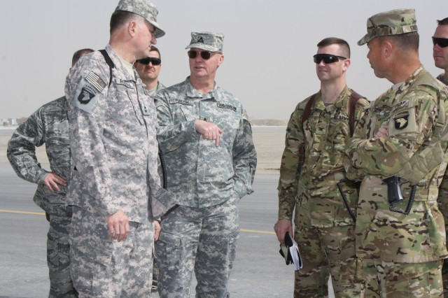 KANDAHAR AIRFIELD, Afghanistan (March 16, 2011) - From left to right: Maj. Gen. James Rogers, commanding general of Aviation and Missile Command; and Richard Hatch, the director of strategic programs for U.S. Forces-Afghanistan; talks with Col. Todd Royar, the 159th Combat Aviation Brigade commander; and Lt. Col. John Smith, the 563rd Aviation Support Battalion commander, on the flight line here March 16. Rogers conducted a command visit to the 159th Combat Aviation Brigade to assess the logistics capabilities and readiness of aviation assets throughout Regional Command-South .  (U.S. Army photo by Spc. Shanika L. Futrell, 159th Combat Aviation Brigade Public Affairs/Released)