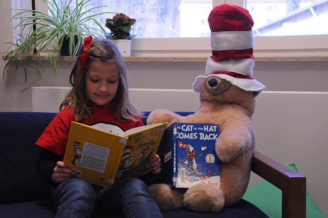 Skyler Smith and friend read together at Hohenfels Elementary School's Read across America celebration.