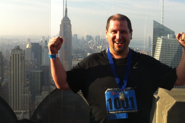 Marc Ivry celebrates atop the Rockefeller Center in New York City, savoring his stair-stepping achievement in raising funds for multiple sclerosis. He placed second as an individual who raised the most funds.