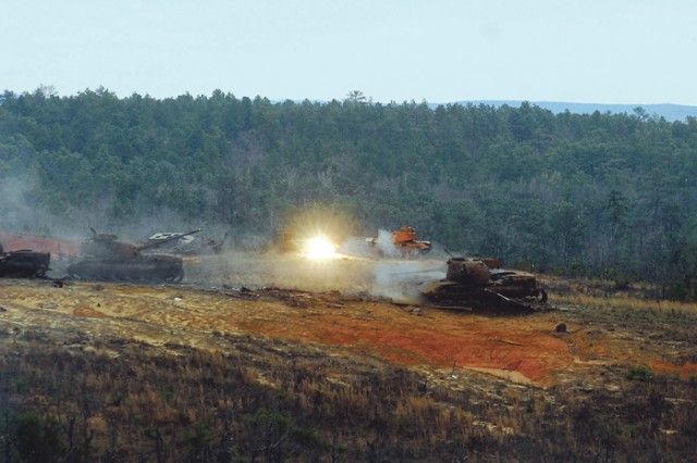 A Bradley round hits its target at Red Cloud Range during a demonstration of Infantry and Armor firepower. The 197th Infantry Brigade conducted a hands-on training exercise with Bradley Fighting Vehicles and tanks.