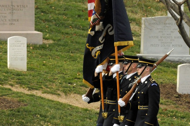 A color guard from 3rd U.S. Infantry Regiment (The Old Guard) marches in the funeral procession for Army Cpl. Frank Woodruff Buckles, the last surviving American World War I veteran, at Arlington National Cemetery, March 15, 2011.